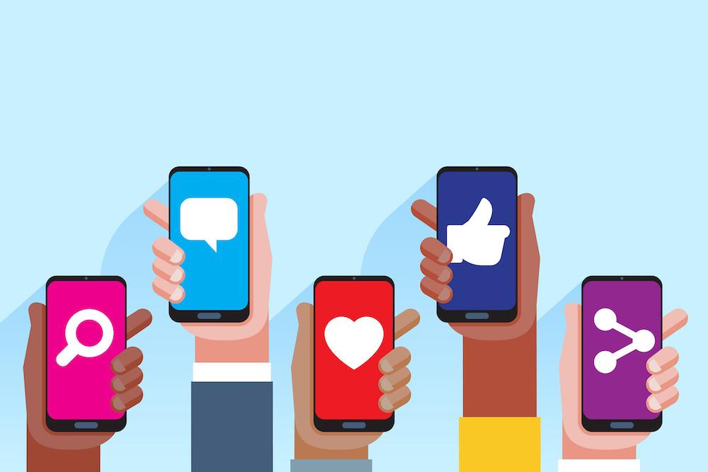 Social media applications. Mobile applications concept. Multi skin color hands raising smartphone